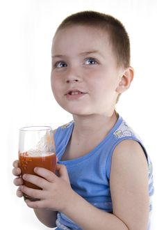 Free The Child Drinks Tomato Juice Royalty Free Stock Photo - 5215405