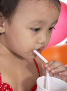 Free Child Sipping Juice Stock Image - 5215651