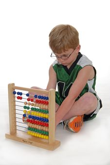 Free Young Boy Using Abacus Royalty Free Stock Images - 5215889