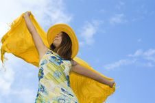 Free Young Woman Holding Orange Wrap Against Blue Sky Royalty Free Stock Photo - 5216245