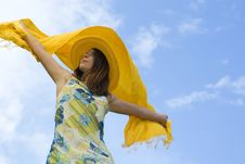 Free Young Woman Holding Orange Wrap Against Blue Sky Royalty Free Stock Image - 5216276