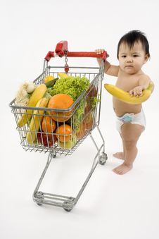 Free Baby Pushes A Shopping Cart Royalty Free Stock Photos - 5217258