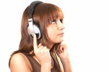 Girl In Brown With Headphones Stock Photos