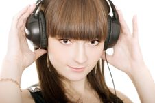 Cute Brunette With Earphones Royalty Free Stock Photos