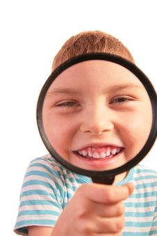 Smiling Child Looks Through Magnifier Stock Image