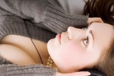 Cute Brunette With Earphones Royalty Free Stock Photo