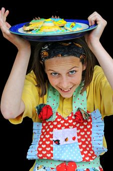 Free Girl In Apron Showing Off Her Biscuits Royalty Free Stock Images - 5224959