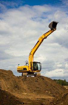 Free Heavy Orange Excavator Reaches The Sky Stock Images - 5227454