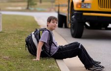 Free Student Near The School Bus Stock Photography - 5229992
