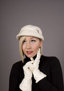 Free Blonde Fur Hat Hand On Chin Looking Up Stock Photography - 5230562