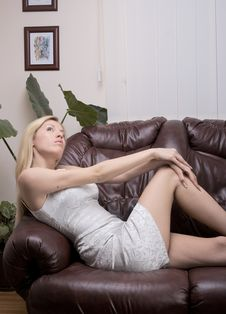 Free Beautiful And Attractive Girl On Sofa Stock Image - 5230641