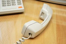 Telephone Receiver Laying On The Table Royalty Free Stock Photo
