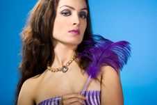 Young Woman With Feather Royalty Free Stock Photography