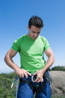 Free Man Checking Climbing Harness - Vertical Stock Images - 5234964