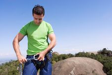 Free Man Checking Climbing Harness - Horizontal Stock Images - 5235084