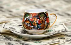 Free Cup Of Coffee Over Dollars Royalty Free Stock Photo - 5237665