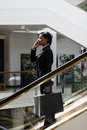Free Businesswoman On Phone On Escalator - Vertical Royalty Free Stock Photography - 5243657