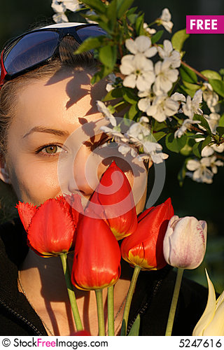Free The Girl With A Bouquet Of Tulips Royalty Free Stock Image - 5247616