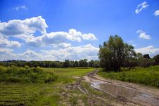Free Rural Dirty - Road With Puddle Royalty Free Stock Images - 5240909
