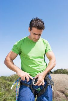 Attaching Rope To Climbing Harness - Vertical Stock Images