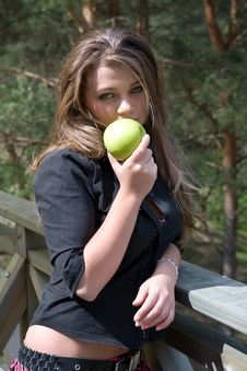 Young Girl With Apple Stock Images