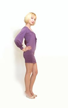 Free Standing Blond Woman In Purple Dress. Stock Photography - 5248042