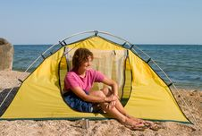 Free Smyling Girl Sitting In The Tent At Sea Coast Stock Photography - 5249592