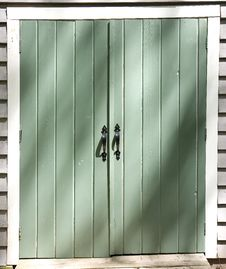 Free Black Handles On Green Doors Royalty Free Stock Image - 5249746
