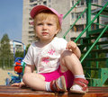 Free Cute Girl Sits On A Bench Stock Photo - 5259470