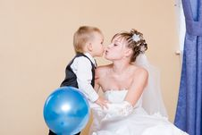 Free A Bride Kisses Her Little Brother Royalty Free Stock Photo - 5251635