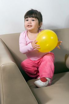 Free Girl With Yellow Balloon Royalty Free Stock Photos - 5252258