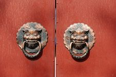 Lion Door Knocker On Red Door Stock Photo
