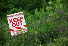 Free No Trespassing Sign In Field Stock Image - 5255271