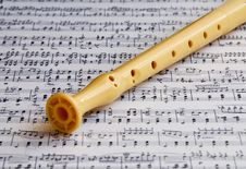 Flute On A Music Sheet Stock Images