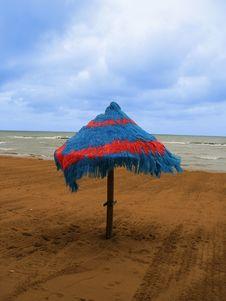 Coloured Umbrella On Autumn Beach Stock Photography