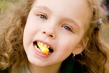Free The Little Girl With A Candy Stock Photography - 5260732