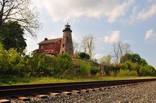 Free Lighthouse By The Tracks Stock Photo - 5262140