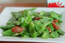 Chinese Cuisine Snow Peas And Chinese Sausage Stock Photos