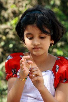 Free Girl Putting The Bracelet Royalty Free Stock Photo - 5264645