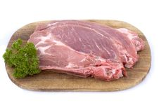 Free Raw Pork Schnitzel With Parsley Stock Photography - 5267782