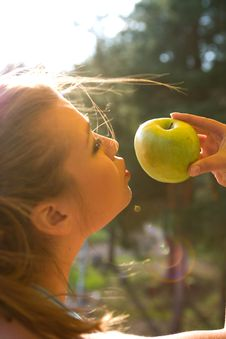 Free Girl With Apple On Sunset Royalty Free Stock Images - 5268779