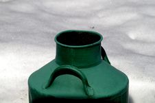 Old Large Milk Can Painted In Green Color In The Snow Stock Photos