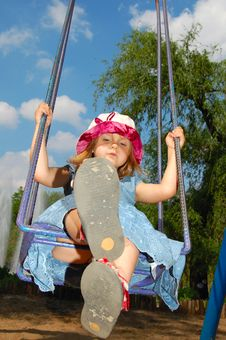 Free Swinging Girl Stock Photo - 5270850