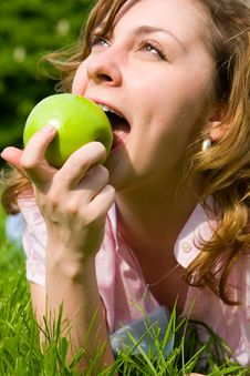 Free Pretty Woman Eating Green Apple Stock Image - 5272351