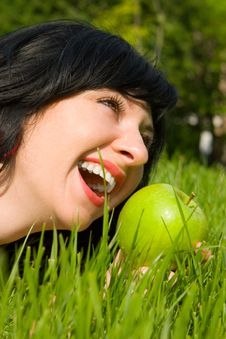 Free Pretty Woman Eating Green Apple Royalty Free Stock Photo - 5272395