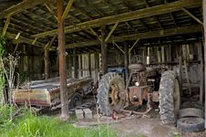 Old Tractor In Shed Royalty Free Stock Images