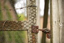 Free Old Lock Secures A Garden Fence Stock Photography - 5279872