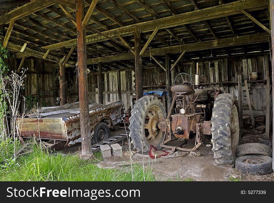 Old Tractor In Shed