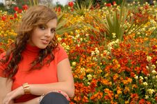 Girl In Red In Beautiful Gardens Royalty Free Stock Image