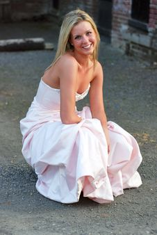 Free Bridesmaid Crouched In Unpaved Lot Stock Image - 5283361